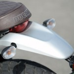 Front and rear aluminum fenders give the motorcycle a vintage image.